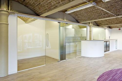 Single glazed partition system in historic building