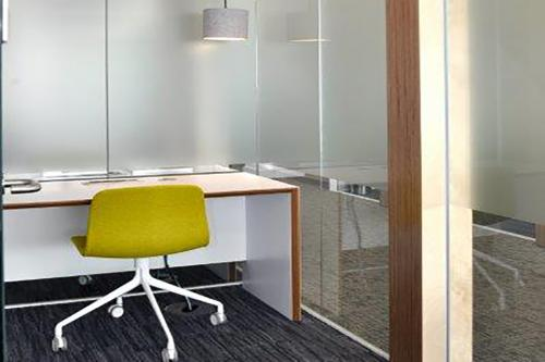 Office pod in single glazed partition system
